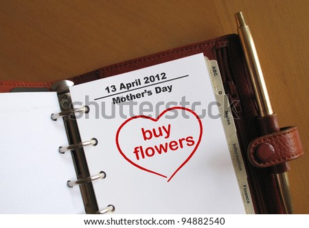 Mother's Day 13 April 2012 in a personal organizer with a note to buy flowers - stock photo