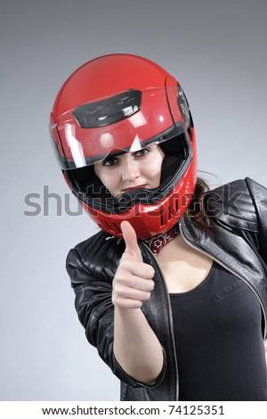 motorcyclist female showing ok sign