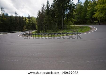 mountain road winding - stock photo