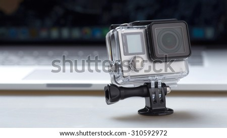 Movement in front of the computer camera - stock photo