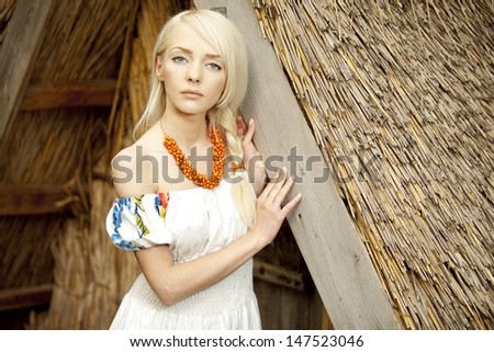 21 Mpix full-frame HD-capture. Professionally retouched. rural woman sitting near by old traditional Ukrainian  barn