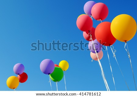 multicolored balloons  in the city festival on blue sky background - stock photo