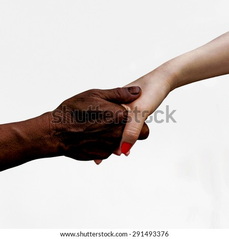 multiracial handshake from an african and a caucasian men hand  - stock photo