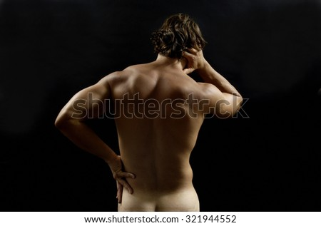 Muscular man with back pain - stock photo