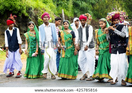 NAGPUR, MAHARASHTRA, INDIA, AUG 10 : group of young women and men Gond tribal perform folk Dance during their religious traditional festival, Gond tribe found in  Maharashtra, India 10 August 2015.