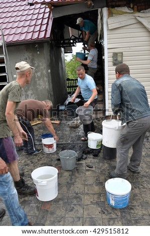 NAHIRYANKA - CHORTKIV - Ukraine - May 31, 2016. The elimination of the fire building, which engulfed two houses, except for emergency services rushed to help neighbors and villagers.