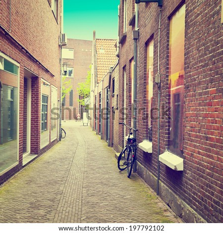 Narrow Street in the Dutch City of Amersfoort, Retro Effect - stock photo