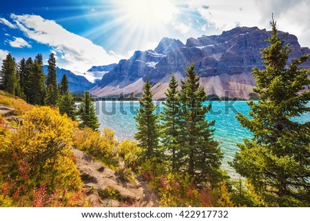 National park Banff, Canadian Rockies. The  mountain glacial Bow Lake with water of emerald color - stock photo