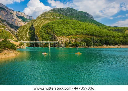 National park Merkantur, Provence, France. Large bridge over the gorge and  river Verdon. White catamarans are sailing on turquoise water