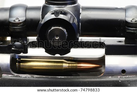 7.62 NATO bullet in a sniper rifle. - stock photo
