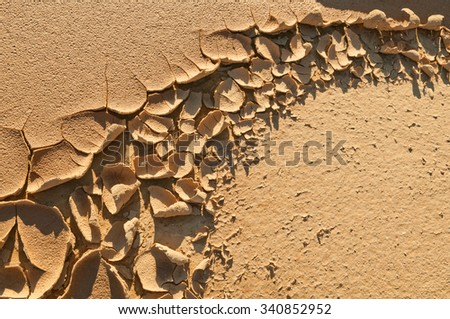 Natural background clay which dried up from heat. - stock photo