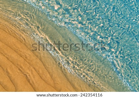 Natural background.Yellow sand and water ripple. - stock photo