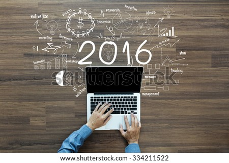 2016 new year business success, Creative thinking drawing charts and graphs strategy plan ideas wooden table background, Inspiration concept with businessman working on laptop computer PC, Top View - stock photo