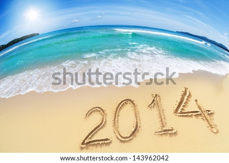 2014 new year digits on beach sand with blue sky