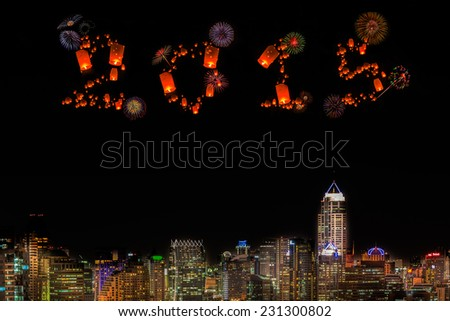 2015 New Year Fireworks celebrating over city at night. - stock photo