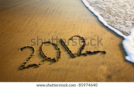 2012 new year message on the sand beach near the ocean. Free space for text - stock photo
