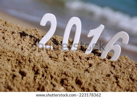 2016 New Year numbers on the sea beach. Background and Texture for text or image - stock photo