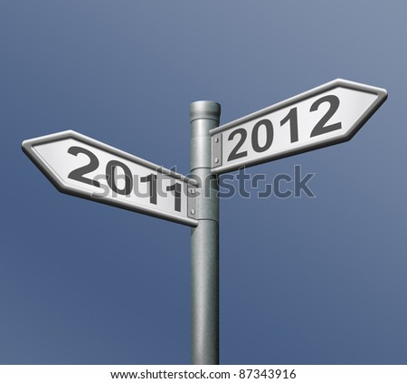 2011 2012 new year road sign arrow pointing towards the future - stock photo