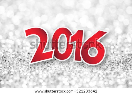 2016 New year text on bokeh defocused lights - stock photo