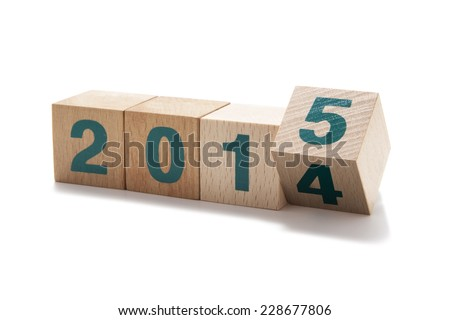 2015 New Year wooden cubes isolated on white - stock photo
