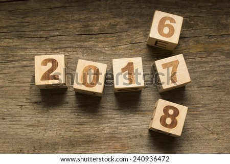 2017 New Year wooden cubes on a wooden background - stock photo