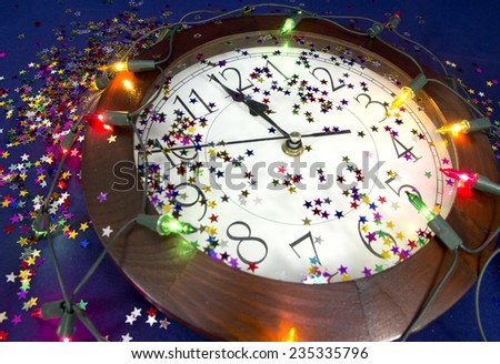 2015 New Years Party Background. Clock, festive tinsels and light - stock photo
