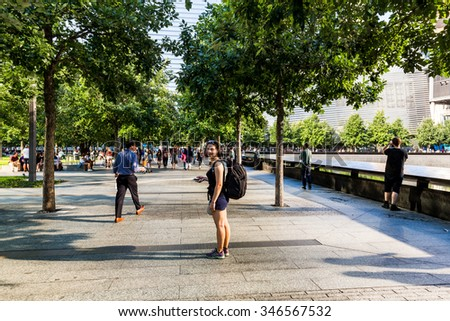 ?NEW YORK - AUGUST 24: Tourist girl near the the Ground Zero in Manhattan Downtown, New York on August 24, 2015. The Ground Zero is a symbol for the terrorist attacks on September 11, 2001. - stock photo