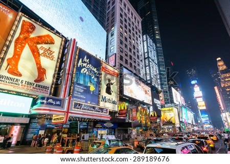 NEW YORK CITY - JUNE 12, 2015: Times Square at night featuring lighted billboards of the broadway best show - stock photo