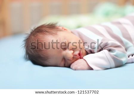 newborn baby sleeps in crib - stock photo