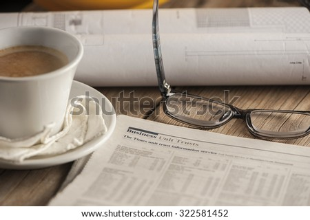 newspaper business page coffee cup - stock photo