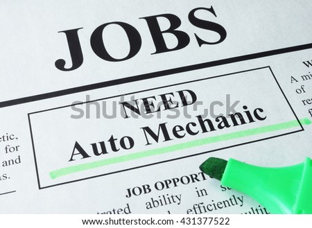 Newspaper with ads for vacancy Auto Mechanic. Employment concept.