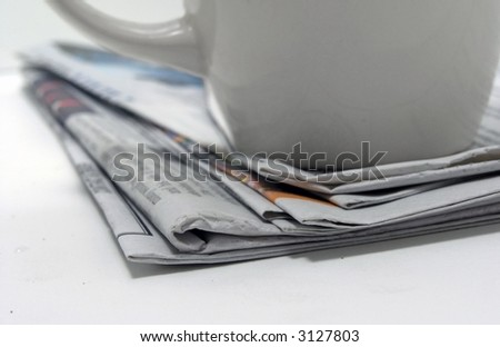 newspapers,and coffee cup