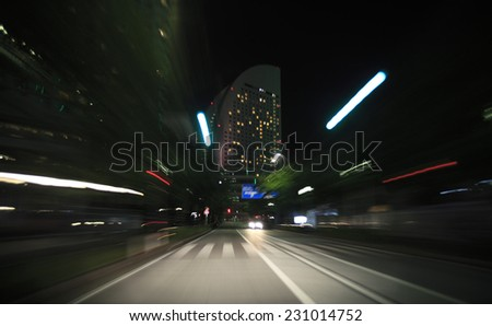 Night drive from car view. - stock photo