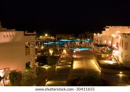 Night panoramic view of rich hotel - stock photo