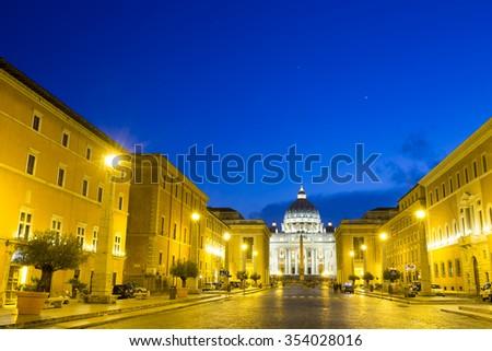 Night view of San Pietro (San Peter) basilica, major touristic landmark in Vatican - Rome captured from Via della Concilliazione. Italy   - stock photo