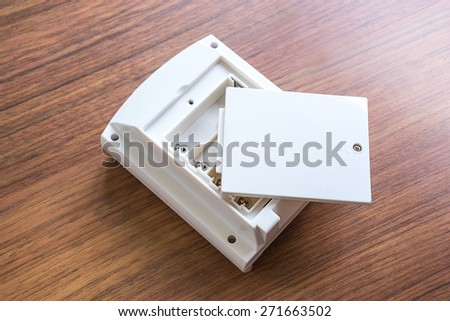 No battery in the socket on wood background - stock photo