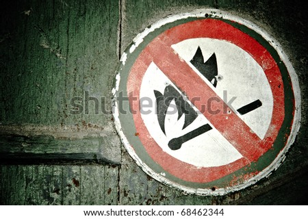"""""""No fire"""" sign on the wall. Grunge style - stock photo"""