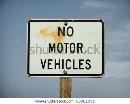 no motor vehicles sign with stain