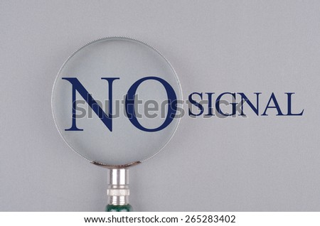 """""""No Signal"""" text concept with magnifying glass - stock photo"""