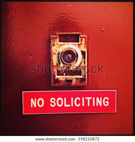 """No Soliciting"" apartment door sign in New York City with Instagram effect filter. - stock photo"