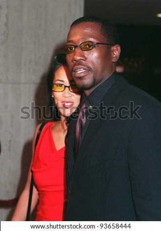 """12NOV97:  Actor WESLEY SNIPES & girlfriend at premiere of his new movie, """"One Night Stand,"""" in which he stars with Nastassja Kinski & Robert Downey Jr. - stock photo"""