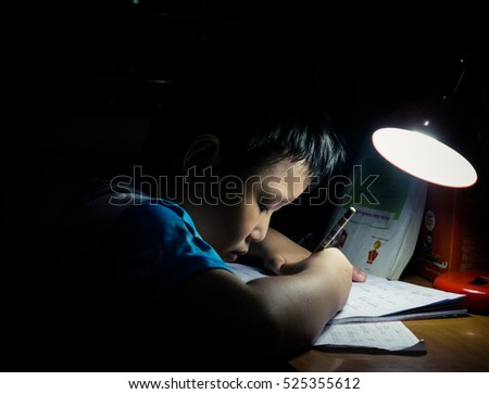 28 NOVEMBER 2016, HCMC, VIETNAM: Student boy studying hard over his book