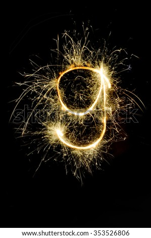 """8"" number drawn with bengali sparkles isolated on black background,number from sparkler on black background - stock photo"