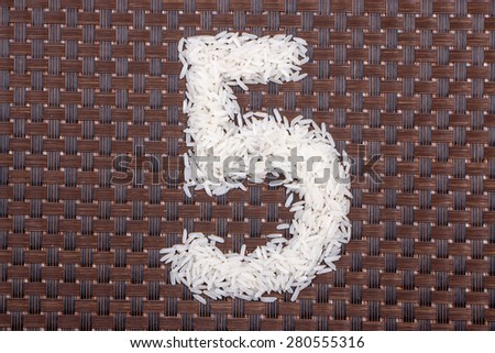 5, number from raw rice - stock photo