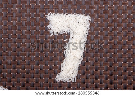 7, number from raw rice - stock photo