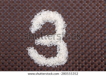 3, number from raw rice - stock photo