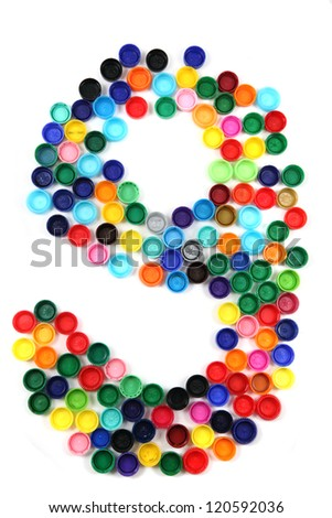 9 - number from the plastic caps isolated on the white background