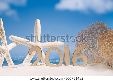 2016 numbers letters with starfish, ocean , beach and seascape, shallow dof - stock photo