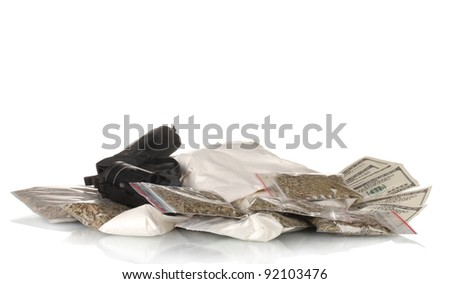 ?ocaine and marijuana in packet with gun isolated on white - stock photo
