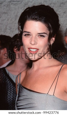 """19OCT99:  Actress NEVE CAMPBELL at Los Angeles premiere of """"Three to Tango"""" in which she stars with Matthew Perry & Dylan McDermott.  Paul Smith / Featureflash - stock photo"""